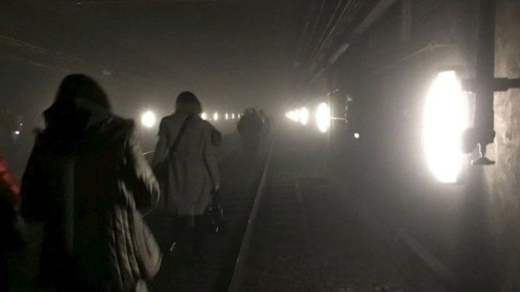 passengers-walk-on-underground-metro-tracks-to-be-evacuated-after-an-explosion-at-maelbeek-train-station-in-brussels-belgium_5568975
